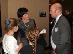 Superintendent Dr. Jeanette Cowherd visiting with Saint Luke's North Hospital CEO Matt Wenzel