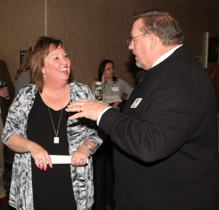 Julie Kloeppel, foundation assistant, visiting with council member Kent Mayfield