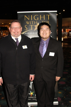 Kent Mayfield, council member, with Lawrence Fang, recipient of the Thelma Battmer Memorial Scholarship