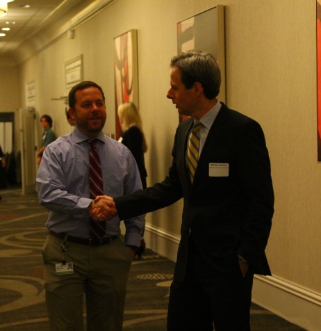 English Landing and Prairie Point assistant principal Matthew Wachel shook hands with council member Michael Atchison.
