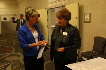 Park Hill School Board member Allison Wurst visited with Education Foundation board member Bev Vogt.