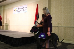Lucy the therapy dog was introduced at the breakfast. A grant helped bring Lucy to Chinn Elementary.