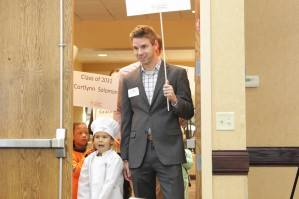 Line Creek Elementary kindergarten student Calea Cooper enters with former Foundation scholarship recipient Tyler Bischof, who is now a physical therapist with SERC. — with Crystal Cooper and Tyler Bischof.