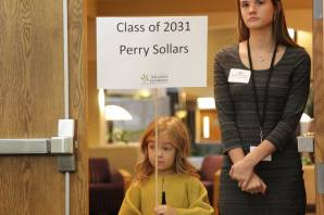 Line Creek Elementary kindergarten student Perry Sollars enters with Foundation intern Danielle Roberson.