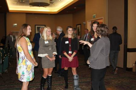 Professional Studies students talk with Director of Communications Nicole Kirby. — with Nicole Kirby.