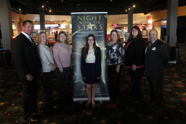 Ashley Gilland (center) recipient of First Student Scholarship with employees of First Student Inc.